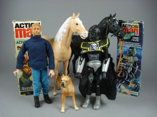 a collection of action man figures in orginal boxes