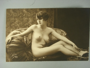 an artisticly posed early 20th centruy erotic postcard