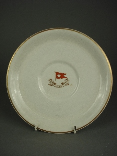 a white star line earthenware bouillon stand