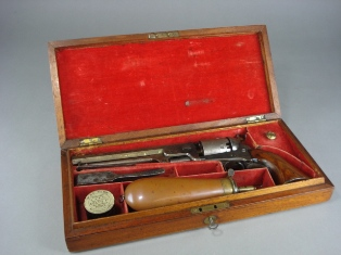 a colt navy 1851 six shot revolver in original case