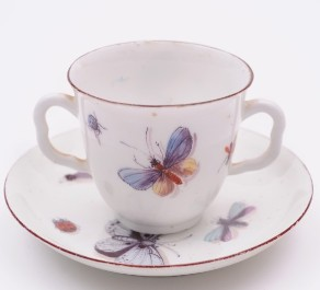 a chelsea porcelain 'red anchor' cup and saucer with butterfly, insect and bird decoration circa 1755