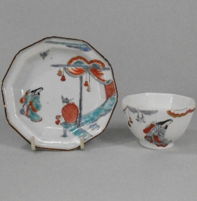 a chelsea lady in a pavillion pattern teabowl circa 1752 and an earlier and similar japanese saucer
