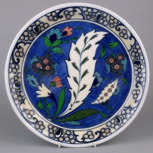 a direct copy of an isnik dish painted by frederick alfred rhead used as inspiration for other pieces.