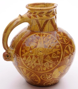a north devon pottery harvest jug showing typical scroll terminal and thumrest