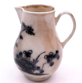 a plymouth porcelain cream jug circa 1768-70 with 'typical' smoke staining