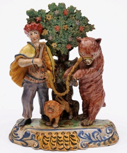 a staffordshire perlware performing bear group circa 1820
