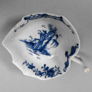 a worcester porcelain butter boat in the transparent rock pattern circa 1758