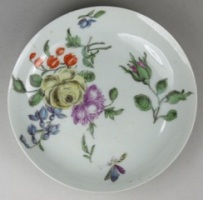 a worcester porcelain saucer with 'european' flowers circa 1760 in the meissen manner