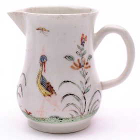 an early worcester porcelain cream jug in the strutting bird pattern circa 1752-53