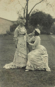 charlotte rhead (standing) and her youngest sister adolphine rhead in playful mood