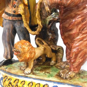 detail of a staffordshire performing bear group, how the mighty have fallen