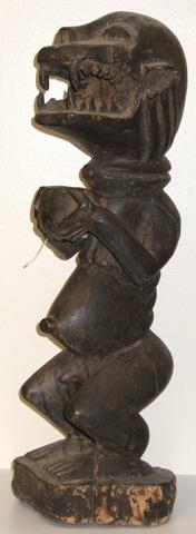 yoruba, nigeria, a carved wooden figure of a monkey