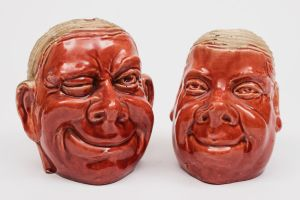 two watcombe (torquay) pottery cress heads (fs24/453).